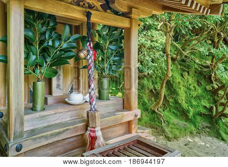 Ceremonial bell rope at the Ginkakuji Temple Kyoto Japan