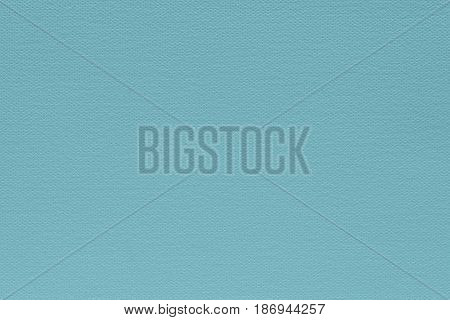 abstract grained texture of speckled fabric or paper material of pale blue color
