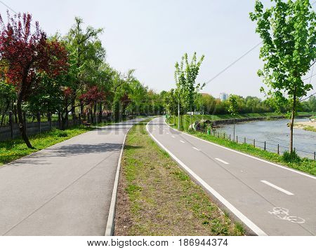 Dedicated bike path adjacent to pedestrian walkway along the river