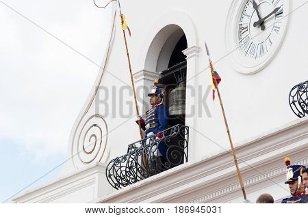 Quito, Ecuador - October 27, 2015:An unidentified man over the balcony of the Presidential palace during the weekly changing of the guards.