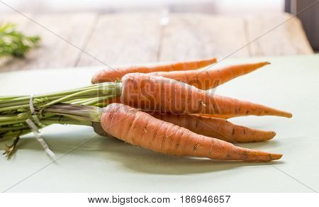 fresh bunch of carrots close up on the table