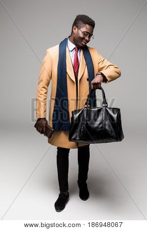 African American Businessman Travel With Bag In Coat Look At Time Isolated