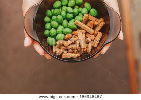 Snack to beer, salted rusks, nuts with wasabi sharp