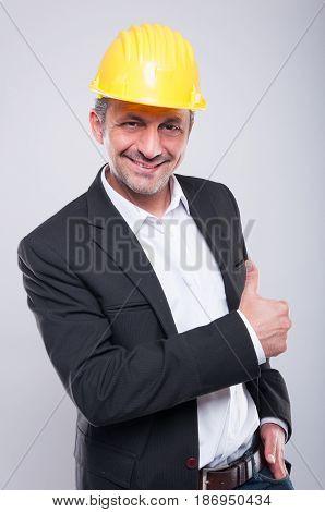 Foreman Wearing Hardhat Making Thumb Up Gesture
