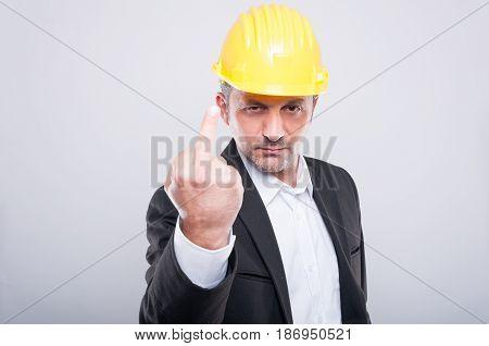 Foreman Wearing Hardhat Making Obscene Gesture