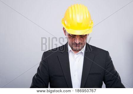 Contractor Wearing Hardhat Arranging Jacket