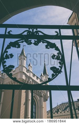 Old Great Guild hall on the background of blue sky through the delicate gate early spring in Riga