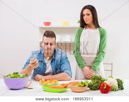 Man is not satisfied with meal made by his wife.