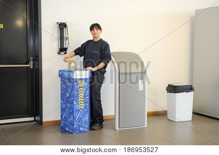 Girl Who Is Recycling A Bottle Of Pet