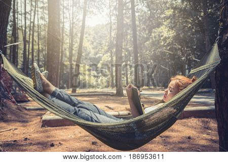 Women sleeping reading. In the hammock. In the natural atmosphere in the park