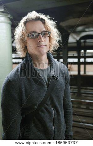 Caucasian man standing in subway
