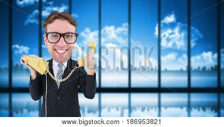 Digital composite of Nerd businessman holding telephone