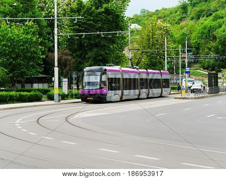CLUJ-NAPOCA ROMANIA - May 7 2017: Modern tram public transportation on the city streets
