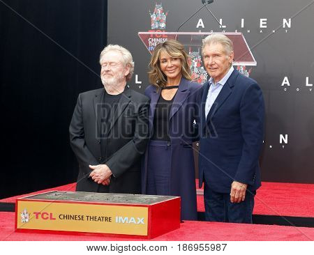 Giannina Facio, Ridley Scott and Harrison Ford at Sir Ridley Scott Hand And Footprint Ceremony held at the TCL Chinese Theatre IMAX in Hollywood, USA on May 17, 2017.