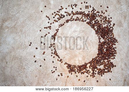 Circle frame of coffee beans large-to-small scale with plenty of copy space for your text inside the circle and at the side