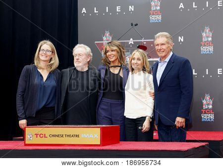 Stacey Snider, Giannina Facio, Ridley Scott and Harrison Ford at Sir Ridley Scott Hand And Footprint Ceremony held at the TCL Chinese Theatre IMAX in Hollywood, USA on May 17, 2017.