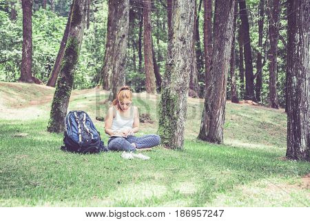 Women write notes Nature trails mountains forests. Writer