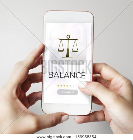 Hands hold device with law on a screen