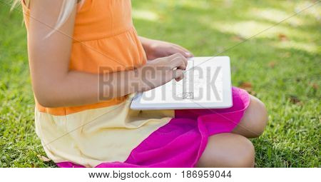Digital composite of Midsection of woman using digital tablet