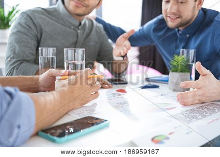 Smiling Young Businessmen Drinking Water And Discussing New Project, Business Teamwork Concept