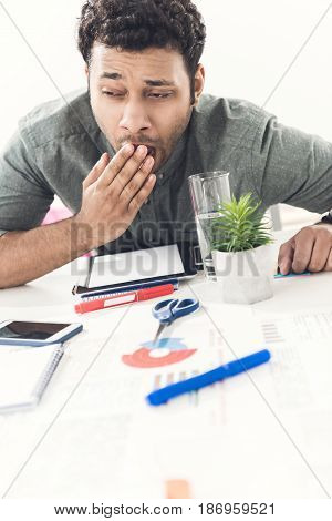 Young Tired Casual Businessman Sitting At Table In Office, Business Establishment