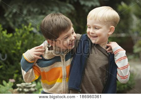 Caucasian boys hugging