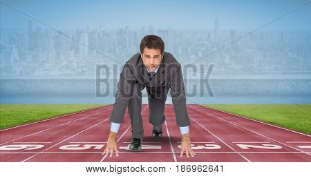 Digital composite of Portrait of businessman at starting line on tracks