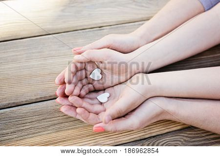 Child And Mother Holding Heart In Hands