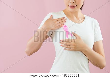 Asian Girl Put Pink Knot Anti-breast Cancer