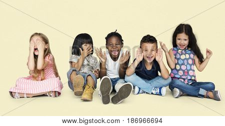Diverse Group Of Kids Playing Together and Cover Face