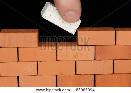 put a white brick in the wall