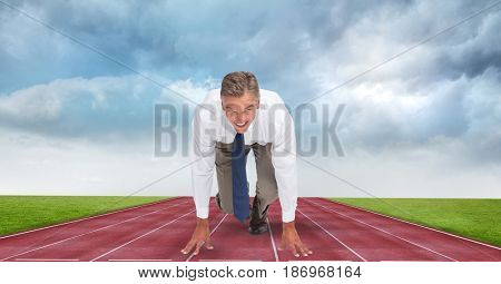 Digital composite of Businessman at starting position on tracks against storm clouds