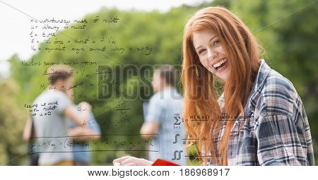 Digital composite of Digital composite image of happy female with math equations