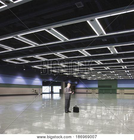 Caucasian businessman standing in empty room