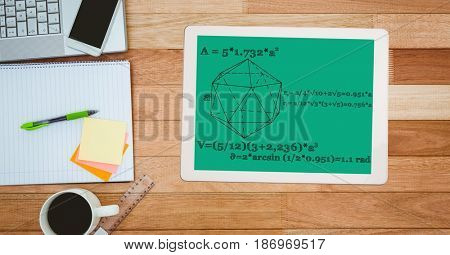 Digital composite of Math diagram and equations on digital tablet by note pad