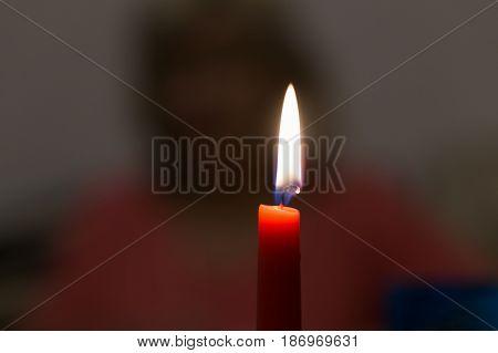 A burning candle background dark photo image