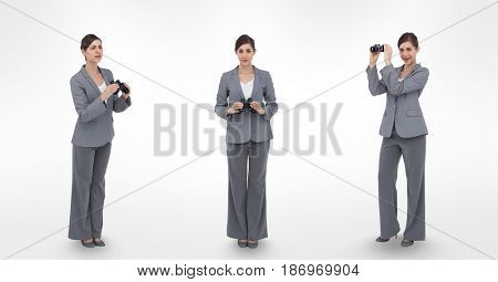 Digital composite of Multiple image of businesswoman holding binoculars