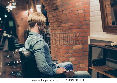 Barbershop Concept. Back Side Portrait Of Bearded Harsh Man. He Has A Fashionable Hairstyle, Modern
