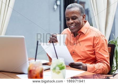 Businessman drinking espresso coffee in a cafe