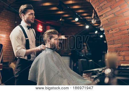 Great Job! Hairstylist And A Client In A Barber Shop. Red Bearded Young Man Got A Stunning Hairdo An
