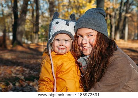 mother and daughter happy hugging in the park