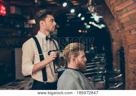 Profile View Of Handsome Classy Dressed Barber Shop Stylist, Who Is Presenting The Result Of His Sty
