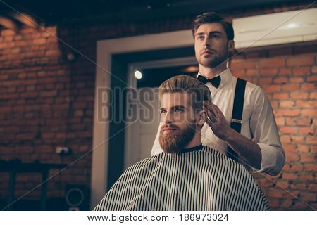 Attractive Classy Dressed Barber Shop Hairdresser Is Turning Client`s Head To Present His Work For H