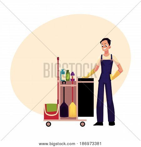 Boy, man, cleaner in overalls with cleaning trolley, cartoon vector illustration with space for text. Full length portrait of young man, boy with professional cleaning trolley