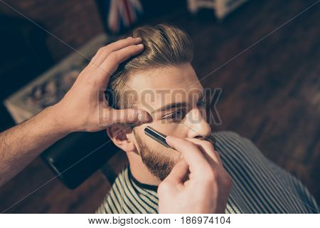 Close Up Of A Hairdresser`s Work For An Attractive Young Blond Man At The Barber Shop. He Is Doing S
