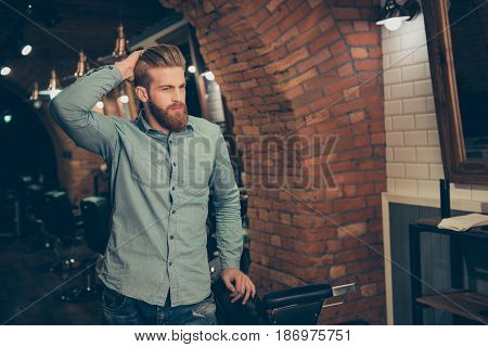 Casual Men`s Life. Perfect! Harsh Stylish Red Bearded Man In A Barber Shop. His Hairstyle Is Spectac