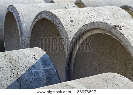 Closeup of many concrete pipes prepared for underground montage
