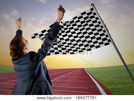 Digital composite of Business woman cheering on track against checkered flag and evening sky