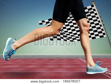 Digital composite of Runner legs on track against blue green background and checkered flag