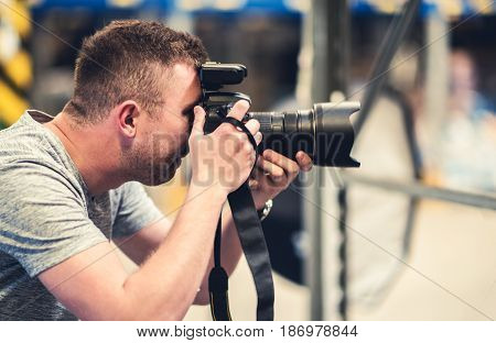 Photographer with Pro Digital Camera Equipment in Hands. Photography Work.